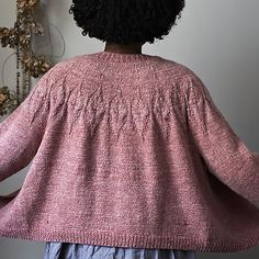 'Winter Whispers' is a lovely cropped cardigan with an unusual cable motif on the yoke.