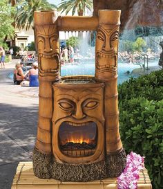 This tropical centerpiece fuses a recirculating water fountain, a realistic yet faux Ultra Fire LED fireplace, and a classic laughing or possibly screaming tiki face.