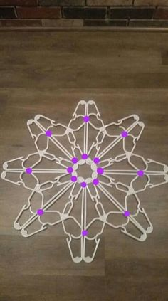 Coat Hanger Snowflake - - This Christmas craft tutorial with pictures gives you instructions on how to make a snowflake wall art using plastic coat or clothes hangers. The hangers that we used were all store bought and can …. Diy Christmas Fireplace, Diy Christmas Snowflakes, How To Make Snowflakes, Outside Christmas Decorations, Snowflake Craft, Snowflake Decorations, Christmas Diy, Christmas Ornaments, Plastic Clothes Hangers
