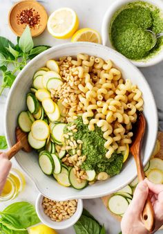 This pesto pasta salad recipe is a simple, delicious summer side dish or meal prep lunch! It's filled with fresh basil, veggies, and pine nuts for crunch.