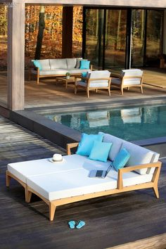 52 Outstanding Outdoor Furnishings | Zenhit teak chaises, three-seater bench, footrest/table, and armchairs with acrylic upholstery by Royal Botania. #design #interiordesign #interiordesignmagazine