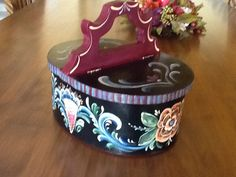 One of a kind Rosemaled Norwegian box. The box maker sews the box closed where the bentwood meets in the Norwegian way.   Available in esty at Cyndi's Folk Art  Cyndisfolkart.com