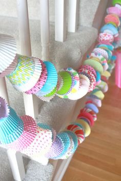 Cupcake Party Garlands. Mix large and mini cupcake liners in various colors and patterns. This handmade adorable cupcake garlands are perfect for party decoration. It works perfectly with stairwells, fireplaces, cake tables as well. http://hative.com/creative-party-ideas/