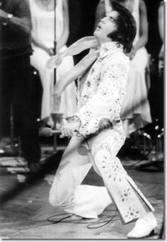 Elvis Going Down to Knees. Here are a couple of photos probably showing Elvis going down into the knee-on-the-stage position. He had to be in motion, because nobody could hold still in those positions for long.