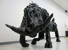 Animal sculptures gothic art taurus from tires