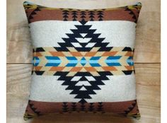 Made with Pendleton® genuine fabric Native American arrows design on front Colors are a black, white, tan, rust brown, medium brown, yellow ochre,