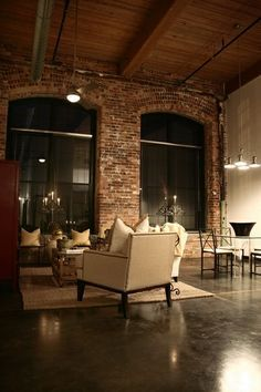 Exposed brick walls, wood ceilings, concrete floor
