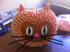 Candy Corn Cat! Use a glue gun to attach candy to the pumpkin.