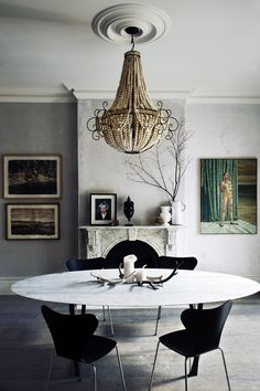 Gorgeous textured dining room with light grey walls and beaded chandelier