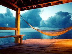 hammock on stormy beach picture and wallpaper