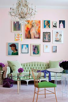 What a great combination, tuffted sofa with a  gallery wall above. Gorgeous!