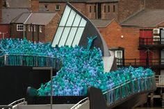 """Naked volunteers, painted in blue to reflect the colours found in Marine paintings in Hull's Ferens Art Gallery, are seen participating in US artist, Spencer Tunick's """"Sea of Hull"""" installation on the Scale Lane swing bridge in Kingston upon Hull on July 9, 2016. Over a period of 20 years, the New York based artist has created over 90 art installations in some of the most culturally significant places and landmarks around the world including the Sydney Opera House, Place des Arts in…"""