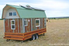 This is the 20 ft. Bitterroot Valley tiny house on wheels by Rocky Mountain Tiny Houses. This off-grid marvel is simple and to the point with solar panels, a composting toilet, and basic kitchen. Solar Panel Kits, Best Solar Panels, Building A Tiny House, Tiny House Plans, Tiny House Kits, Off Grid Tiny House, Landscape Arquitecture, Eco Buildings, Best Tiny House