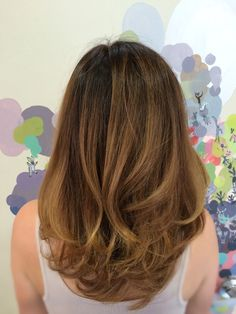 """Color: Root touch up and Balayage, incorporating dark warmer tones revealing a Tortoise Shell or Ecaille color palette Cut: Long textured bob """"The Lob"""""""
