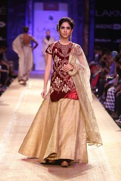 Maroon and gold Indian wedding lehnga with long blouse by Anju Modi at Lakme Fashion Week Winter 2014. More here: http://www.indianweddingsite.com/lakme-fashion-week-winter-2014-anju-modi-collection/