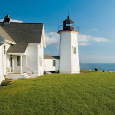 Wings Neck Lighthouse - Cape Cod, Massachusetts. The keeper's cottage sleeps eight, and includes a living room with stone fireplace and a crisp, white, eat-in kitchen.