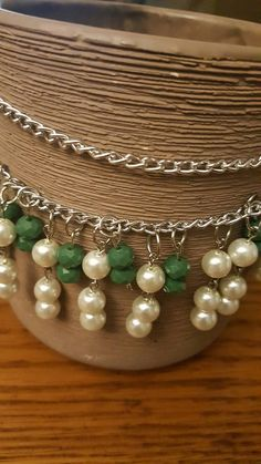 Check out this item in my Etsy shop https://www.etsy.com/listing/484643343/white-and-green-bead-necklace-crystal