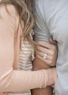 I know this is an engagement photo but I love the arm wrap around and I think it would be a beautiful picture