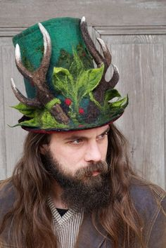 This unique felted high hat for Christmas, festive top hat with reindeer horns will be great addition to creating the Holidays unusual look! It made of merino and Tyroleans sheep wool. Horns and leaves are felted together with hat, not sewn. Inside hat is red. Reindeer horns are felted around special wire. Unique high-hat for men, but also will be great for women. Light and funny. A piece of art on your head! Woodland look!  Head circumference -ca 56 - 58 cm ( 22- 23) height - ca 22 cm (8,5)
