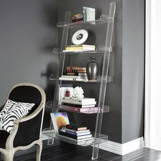 love the wall color and the acrylic bookshelf (from wisteria) Leaning Bookshelf, Leaning Shelf, Bookshelves, Bookshelf Plans, Bookshelf Styling, Lucite Furniture, Acrylic Furniture, Home Decor Furniture, White Baseboards