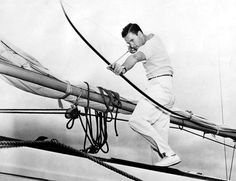 """oldhollywoodmonamour: """"Errol Flynn fishes with bow and arrow on his ketch Sirocco """" Classic Hollywood, Old Hollywood, Hollywood Pictures, Hollywood Glamour, Jack Warner, Los Angeles Usa, Errol Flynn, Target Practice, Traditional Archery"""