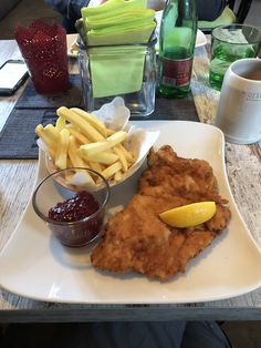 Delicious Austrian meal of Wiener Schnitzel with fries and cranberry sauce Wiener Schnitzel, Gap Year, Cranberry Sauce, Oysters, Earn Money, Austria, Skiing, Fries, Meals