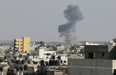 """Smoke is seen after what witnesses said was an Israeli air strike in Gaza City August 19, 2014. Israel launched attacks in the Gaza Strip on Tuesday and recalled its negotiators from truce talks in Cairo after saying three Palestinian rockets had hit southern Israel, hours before a ceasefire was due to expire. A Reuters correspondent saw an Israeli plane fire a missile east of Gaza City. The Israeli military said it was attacking """"terror targets"""" across the territory. (REUTERS/Suhaib Salem)"""