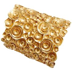 A very limited production Yves Saint Laurent weighty gold-tone cuff bracelet inspired by the Byzantine period.