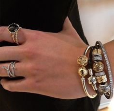 PANDORA Bracelet Stack with Gold and Silver Charms and Black Leather.