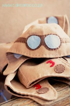 Aviator hats for dress up! Could teach basic aerodynamics, different kinds of aircraft, or do a lesson on Amelia Earhart.
