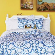 Yellow walls, blue & white bedding