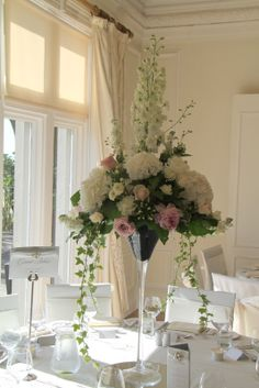 Our splendid Martini Vase design topped with Delphiniums, Roses and Hydrangeas