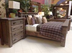 A rustic style bedroom with beautiful raw-looking wood treatment! | Houston TX | Gallery Furniture |