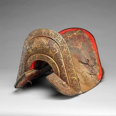 Saddle [gser sga] (image 1)   Tibetan   15th-17th century   Iron, gold, copper, wood, leather   Metropolitan Museum of Art   Accession Number: 2002.225
