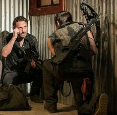 Andrew Lincoln and Norman Reedus as Rick Grimes and Daryl Dixon