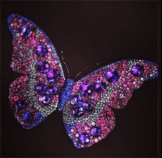 JAR Butterfly brooch with rubies, amethysts, sapphires, and diamonds. Joel Arthur Rosenthal