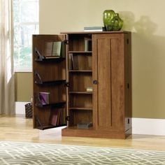 """CD DVD Blu-Ray Multi Media Storage Cabinet - Oiled Oak Finish by TDM. $159.98. Features This versatile multimedia storage tower stores up to 529 CDs, 416 DVDs, 213 cardboard case VHS tapes or 156 oversized case VHS tapes. Doors swing open 180 degrees for easy access. Four adjustable shelves. Multimedia storage tower comes in Oiled Oak finish.     Dimensions W:28 1/8"""" (71.4cm) D:13"""" (33.0cm) H:44 7/8"""" (113.9cm). Comes ready to assemble. Please contact Target Decor and ..."""