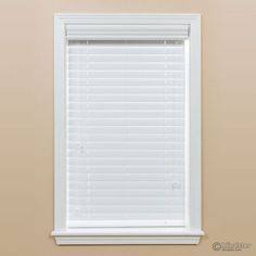 2in deluxe faux wood blind mounted in a window