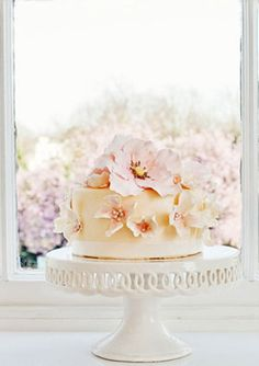 Pretty pretty wedding cake with pink briar roses and dogwood flowers