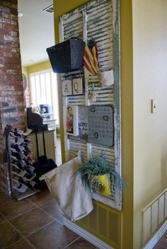 Tall shutter repurposed into message board Hooks, bags, buckets, cork board, calendar, decorations, etc.