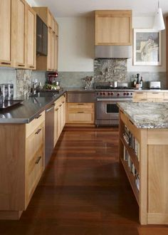 Or hang a piece of granite behind the range that matches for a clean, non cluttered look.
