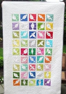put a bird on it - i love how she used the positive & negative space of the charm squares