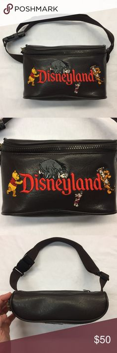 Disneyland Faux Leather Waist Bag / Fanny Pack Disneyland Faux Leather Waist Bag / Fanny Pack - Rare Embroidered Disneyland and Winnie The Poo characters. Honey pot zipper pull.  One large compartment and one zip pouch pocket.  100% PVC  No holes, cuts or stains. Excellent condition.  Feel free to make me an offer.  Discounts on bundles. Disney Bags