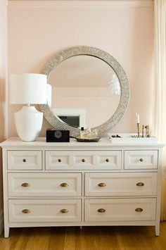 I like that the mirror is resting on the chest of drawers rather than being on the wall