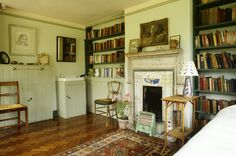 Virginia Woolf's bedroom, with her collection of books, many of which she recovered with colored paper.