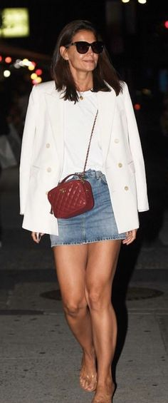 Katie Holmes Street Style. Katie Holmes Saint Laurent White Blazer, Red Chanel Bag, and Re/Done Denim Skirt.