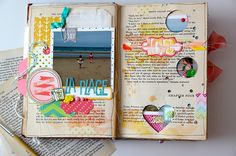 Love the punched out heart and circles on the book page that frame photos!! Great idea!!!