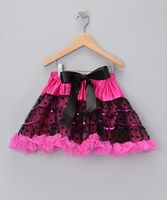 For the little gal who's particular—peanut butter and jelly with no crust, thank you very much—this pretty piece is sure to please. With plenty of glitter and lots of glitz, it's a twirling delight.Includes skirt and hangerFits sizes 3 to 4Waist: 18'' circumferenceLength: 12'...