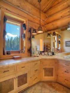 Exquisite Log Home On Three Levels Of High Quality Architecture