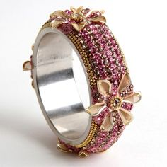 Flower Bangle made in lac..!!!   Made in cold lac and coated with stone work..!!! This imitation bangle contains a metal flower..!!! 1 pc set..!!    Size: 2.4, 2.6, 2.8, 2.10  Rs. 720